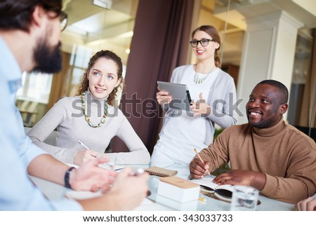 Happy colleagues listening to viewpoint of businessman
