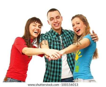 Happy college friends , their hands together, isolated on white background
