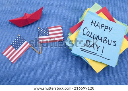 Happy Columbus Day note with red paper boat and American flags
