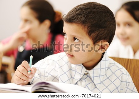 happy competitive working successful kids in the school, classroom - stock photo