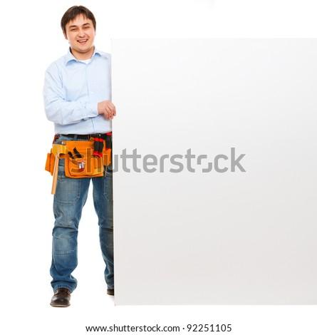 Happy construction worker holding blank billboard - stock photo
