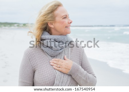 Happy contemplative casual senior woman looking away at the beach