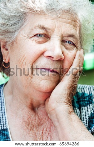 Happy content senior old friendly woman - stock photo