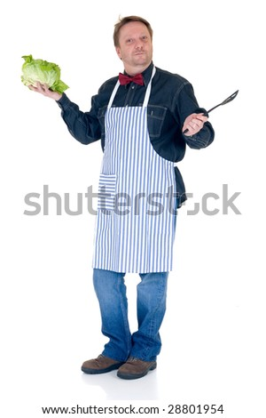 Happy cook showing some fresh salad and spoon on white background, reflective surface - stock photo