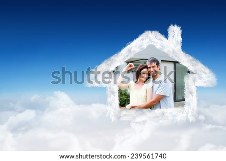 Happy couple after buying house against blue sky over clouds - stock photo