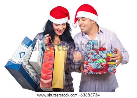 Happy couple at shopping for Christmas  looking in bags and  being satisfied of what they bought isolated on white background - stock photo