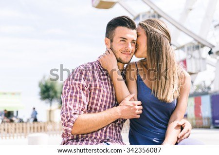 Happy couple at the amusement park. concept about relationship and love