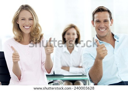 Happy couple at the bank - stock photo