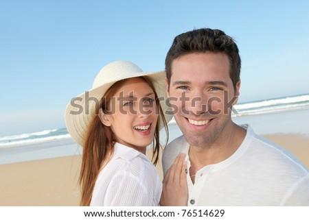 Happy couple at the beach - stock photo
