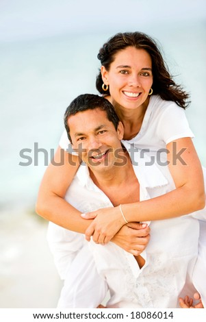 happy couple at the beach during vacation - stock photo