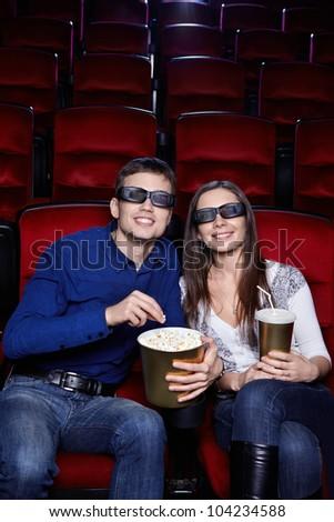 Happy couple at the cinema - stock photo
