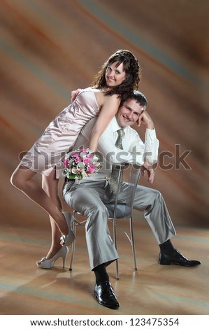 happy couple at the wedding on brown background