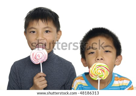 Happy couple  boy holding candy - stock photo
