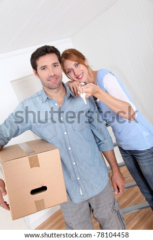 Happy couple buying new house