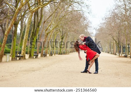 Happy couple dancing in the Luxembourg garden of Paris - stock photo