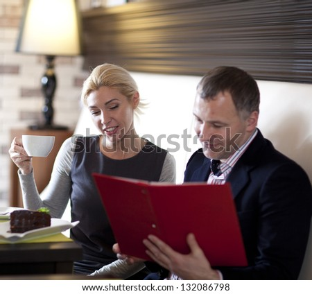 happy couple dining out in restaurant and reading menu - stock photo