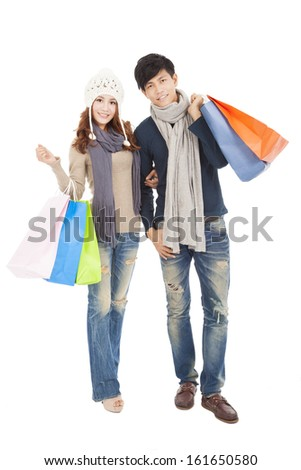 Happy couple doing shopping together - stock photo