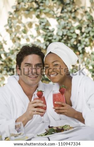 Happy couple drinking srtawberry shake - stock photo