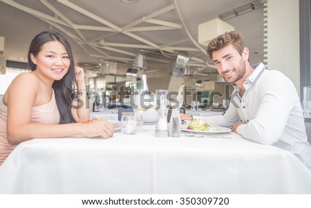 Happy couple eating in a restaurant. Concept about couple and relationship - stock photo