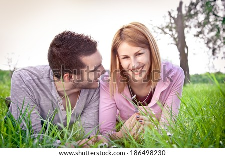 Happy couple ejoying outdoor in park.  - stock photo