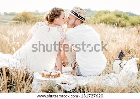 Happy couple embracing and laughing - stock photo