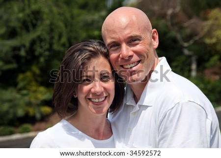 Happy couple embracing outside - stock photo
