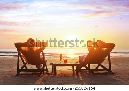 happy couple enjoy luxury sunset on the beach during summer vacations - stock photo