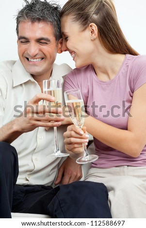 Happy couple enjoying glasses of champagne flutes