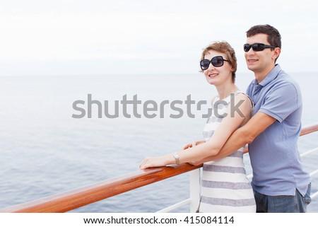 happy couple enjoying honeymoon at cruise ship - stock photo