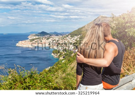 Happy couple enjoying the view of Dubrovnik, Croatia on their travels - stock photo