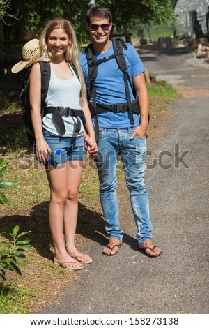 Happy couple going for a trek together on a sunny day