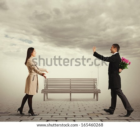 happy couple going to meet each other in the park