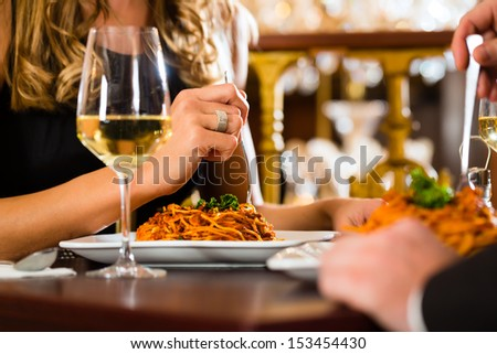 happy couple have a romantic date in a fine dining restaurant, closeup - stock photo
