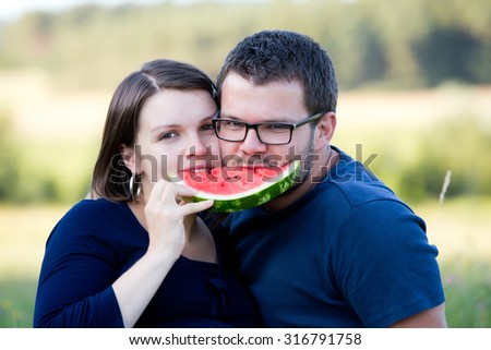 Happy couple have picnic outdoor. - stock photo