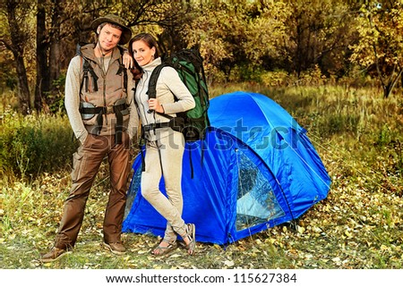 Happy couple having a rest outdoor in tent. - stock photo