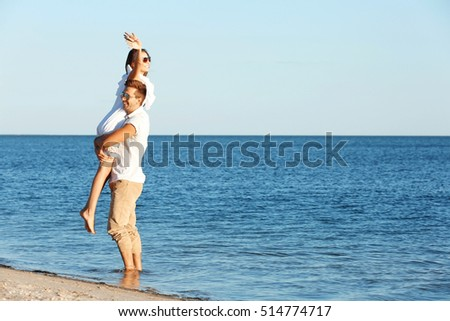 Happy couple having date on seashore