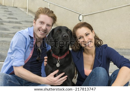 Happy couple having fun with dog, Outdoor Shot