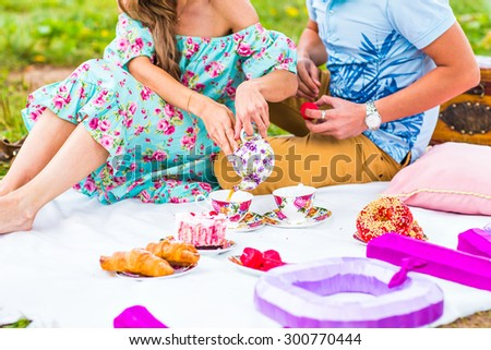 Happy Couple Having Romantic Picnic Together Outside - stock photo