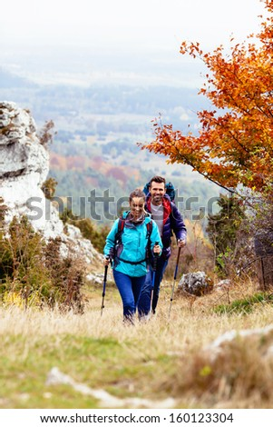 Happy couple hiking during autumn - stock photo