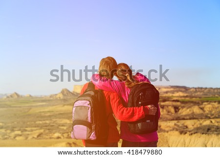 happy couple hiking in scenic mountains - stock photo