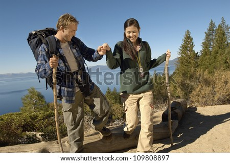 Happy couple hiking on a sunny day