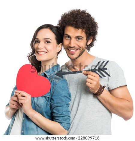 Happy Couple Holding Arrow And Paper Heart Isolated White Background - stock photo