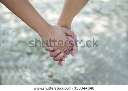 Happy couple holding hands.focus on hands. - stock photo