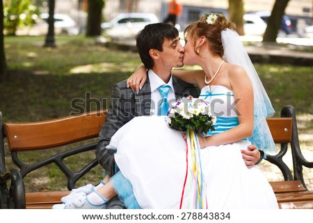 happy couple hugging and kissing on background park