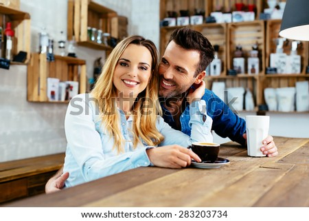 Happy couple hugging at cafeteria - stock photo