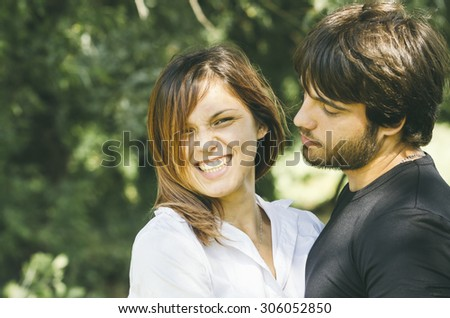Happy couple hugging in nature - stock photo