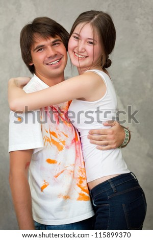 Happy couple hugging while  remodeling - stock photo