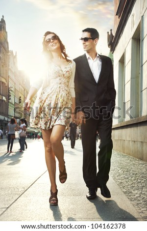 Happy couple in a city center - stock photo