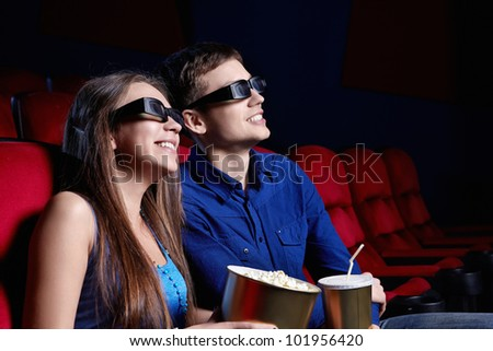 Happy couple in a movie theater - stock photo