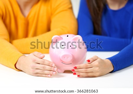 Happy couple in a room with money
